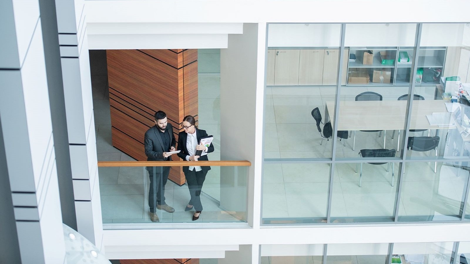Workers at balcony shutterstock 1634800297